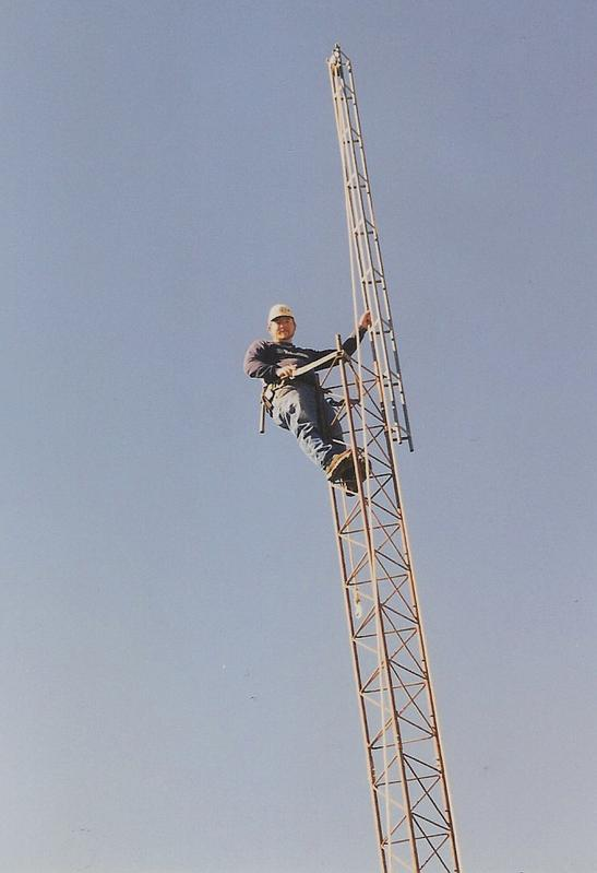 Erecting the old tower in Katy in the 1990's